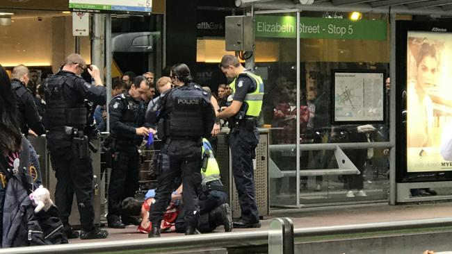 "Bystanders reportedly feared for their lives and phoned police after a man was heard yelling abuse and wanting to ""shoot everyone"". Picture: Mikaela Day"