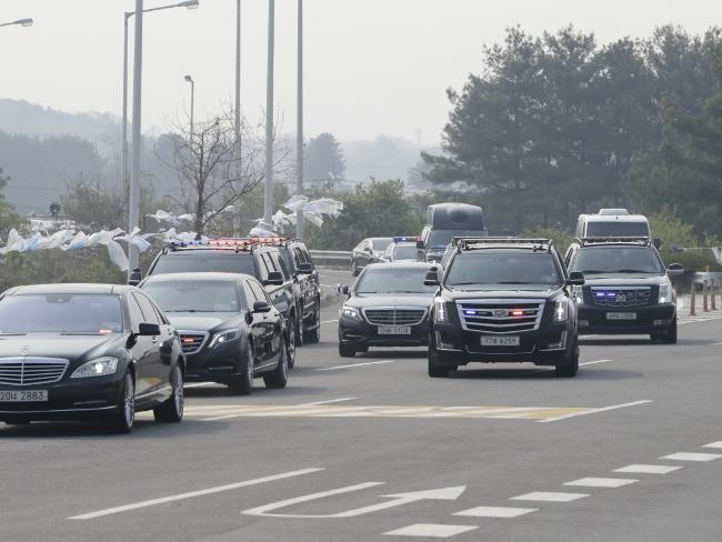 A motorcade carrying South Korean President Moon Jae-in arrives at the Unification Bridge, which leads to the Panmunjom in the Demilitarized Zone, in Paju. Picture: Lee Jin-man/AP
