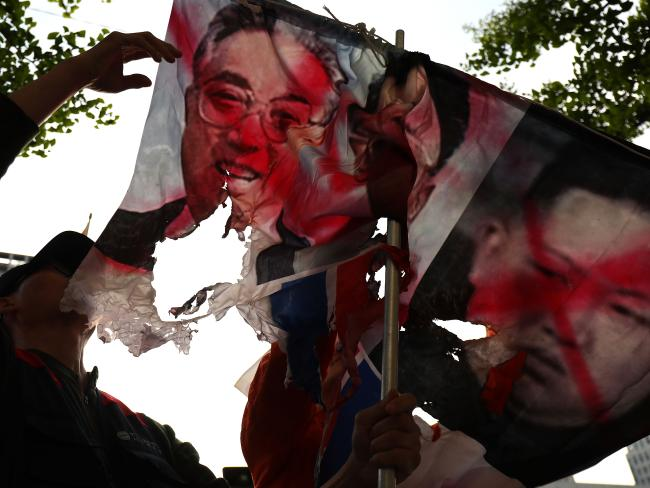 Not all South Koreans are thrilled about the summit with protesters making their views known ahead of the meeting by burning pictures of the North Korean regime. Picture: Chung Sung-Jun/Getty Images