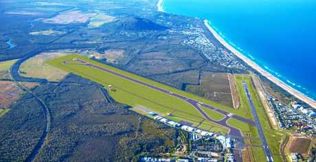An artist's impression of the new 2450m long airstrip to be installed at the Sunshine Coast Airport by 2020, showing the existing runway still in place.
