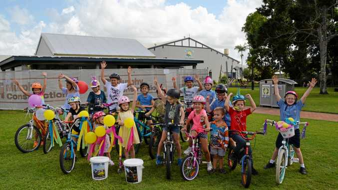 RIDE READY: Local school children before they lead the Tour de Cure riders through the Main St in Proserpine on Saturday morning.