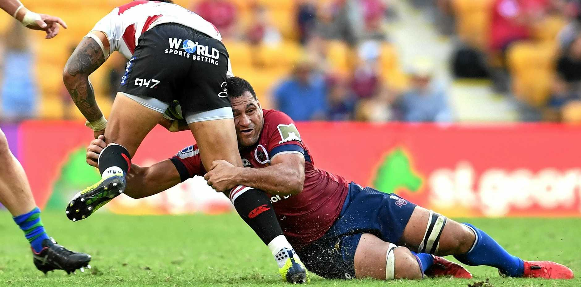George Smith of the Reds, right, tackles the Lions' Elton Jantjies during their sides' Round 11 Super Rugby match in Brisbane on Saturday. Picture: Dan Peled/AAP