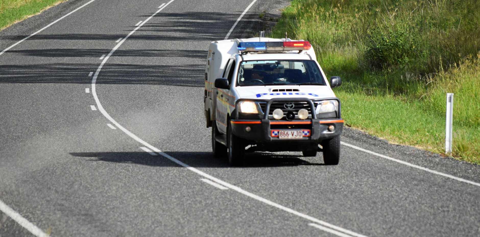 A police car speeds down the road.  Photo Tobi Loftus / Central & North Burnett Times