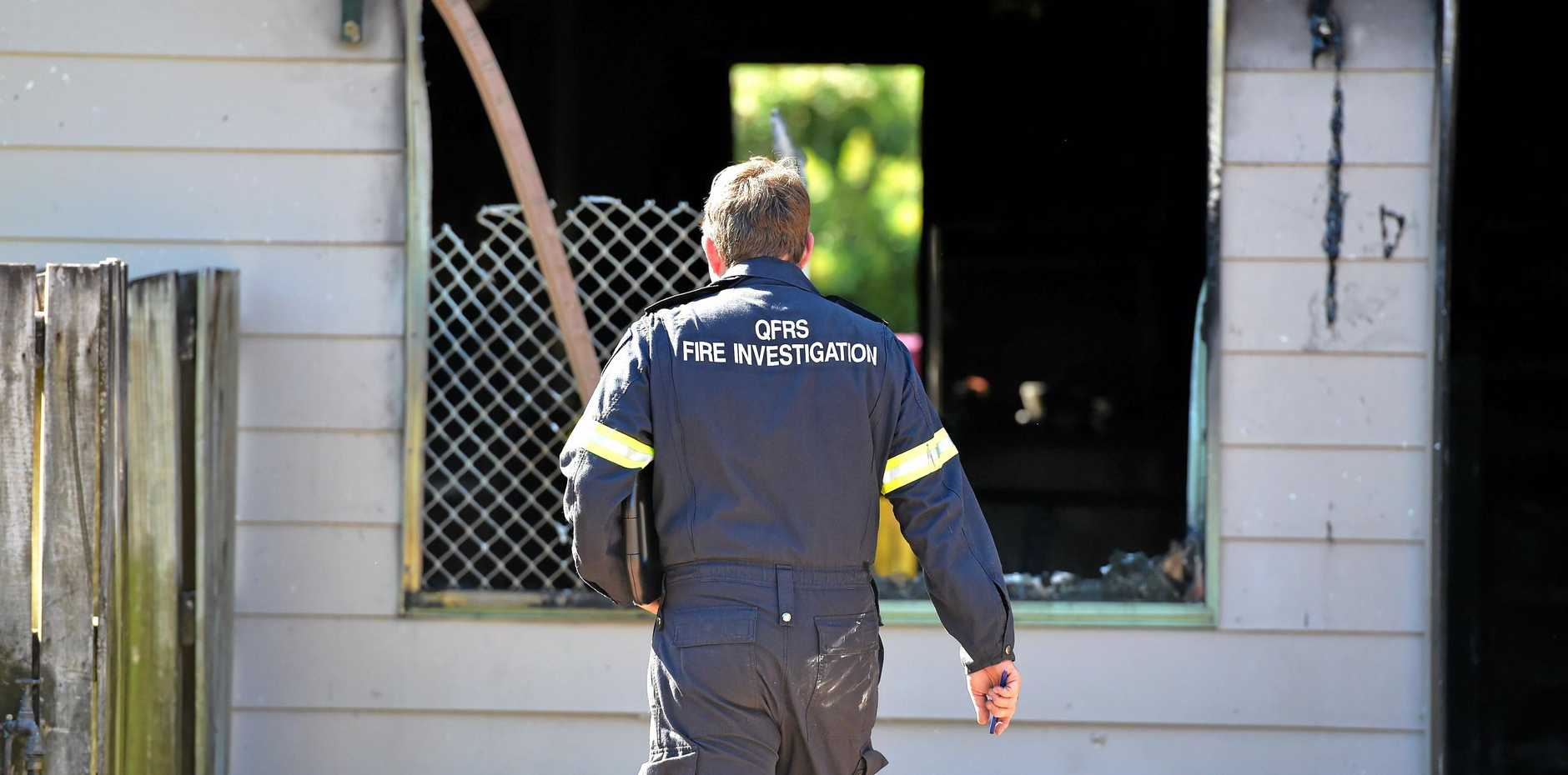 INVESTIGATING: A fire investigator on the scene of the fire at Hinkler Parade, Maroochydore.