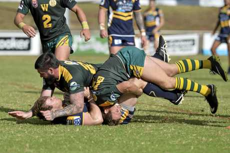 WRAPPED UP: Highfields player Josh Everett is tackled by Dylan Wilson (left) and Harry Fulwood of Wattles.