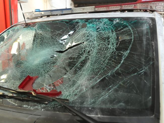 The smashed windscreen of a police car. Picture: David Crosling