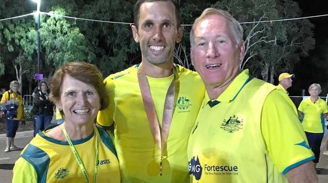 STAUNCH SUPPORTERS: Proud parents Barb and Ryan Knowles celebrate with Mark after his gold-medal win.