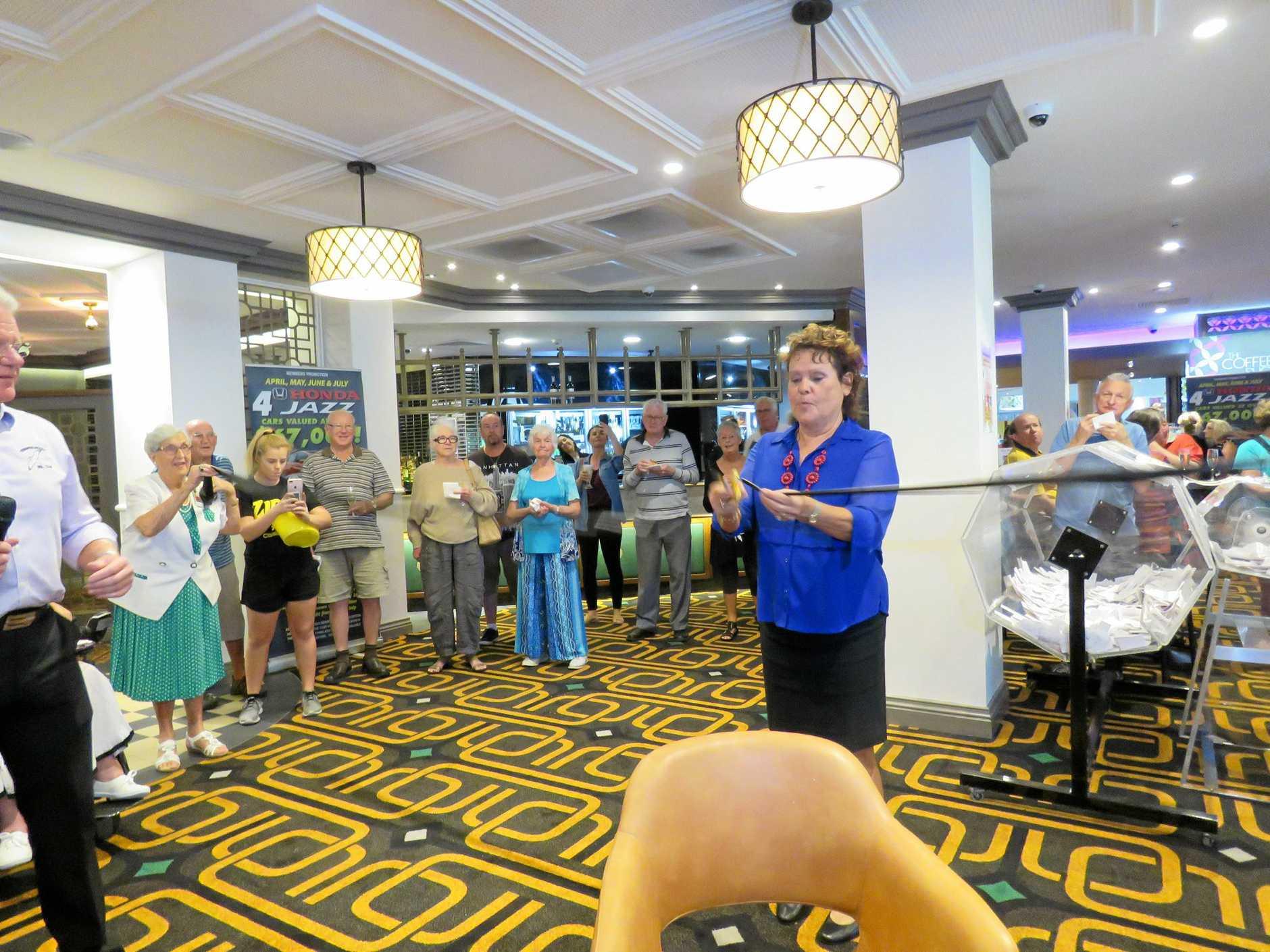 CELEBRITY: Evonne Goolagong-Cawley cuts the ribbon celebrating the  upgrade at Tewantin Noosa RSL.