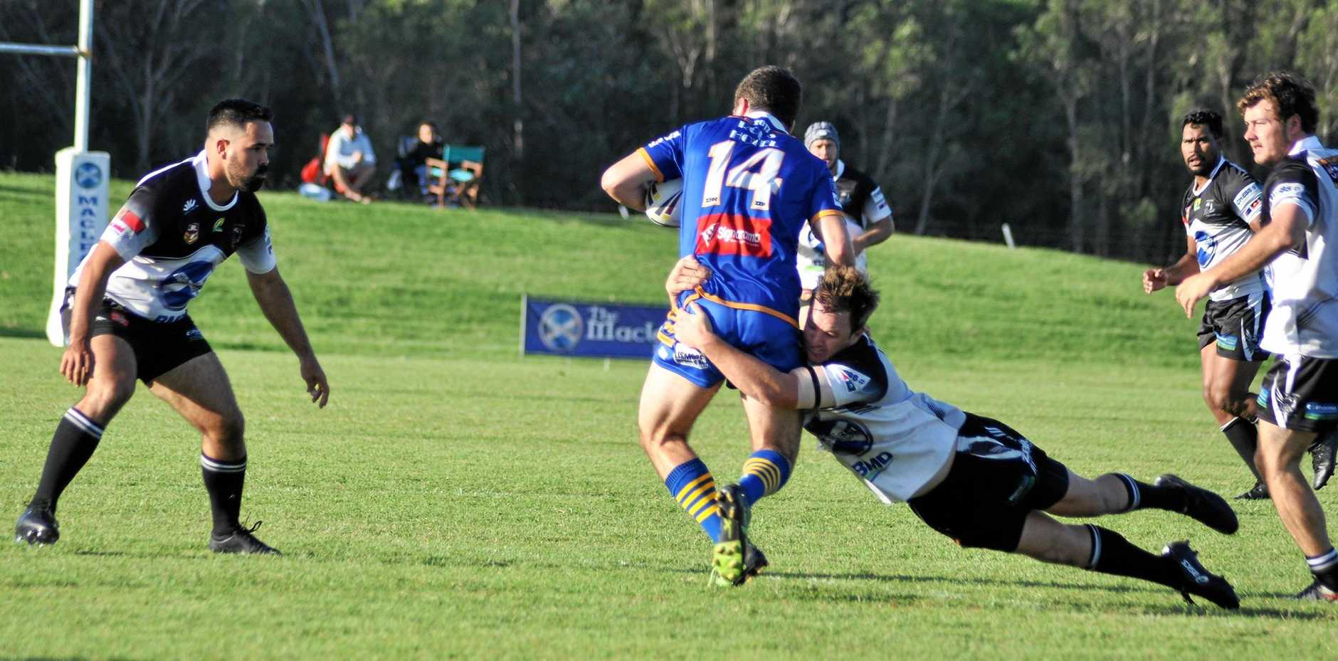 BROUGHT DOWN: Lower Clarence Magpies captain Tom Martin puts in a tough tackle to stop an advancing Marist Bros attacker.