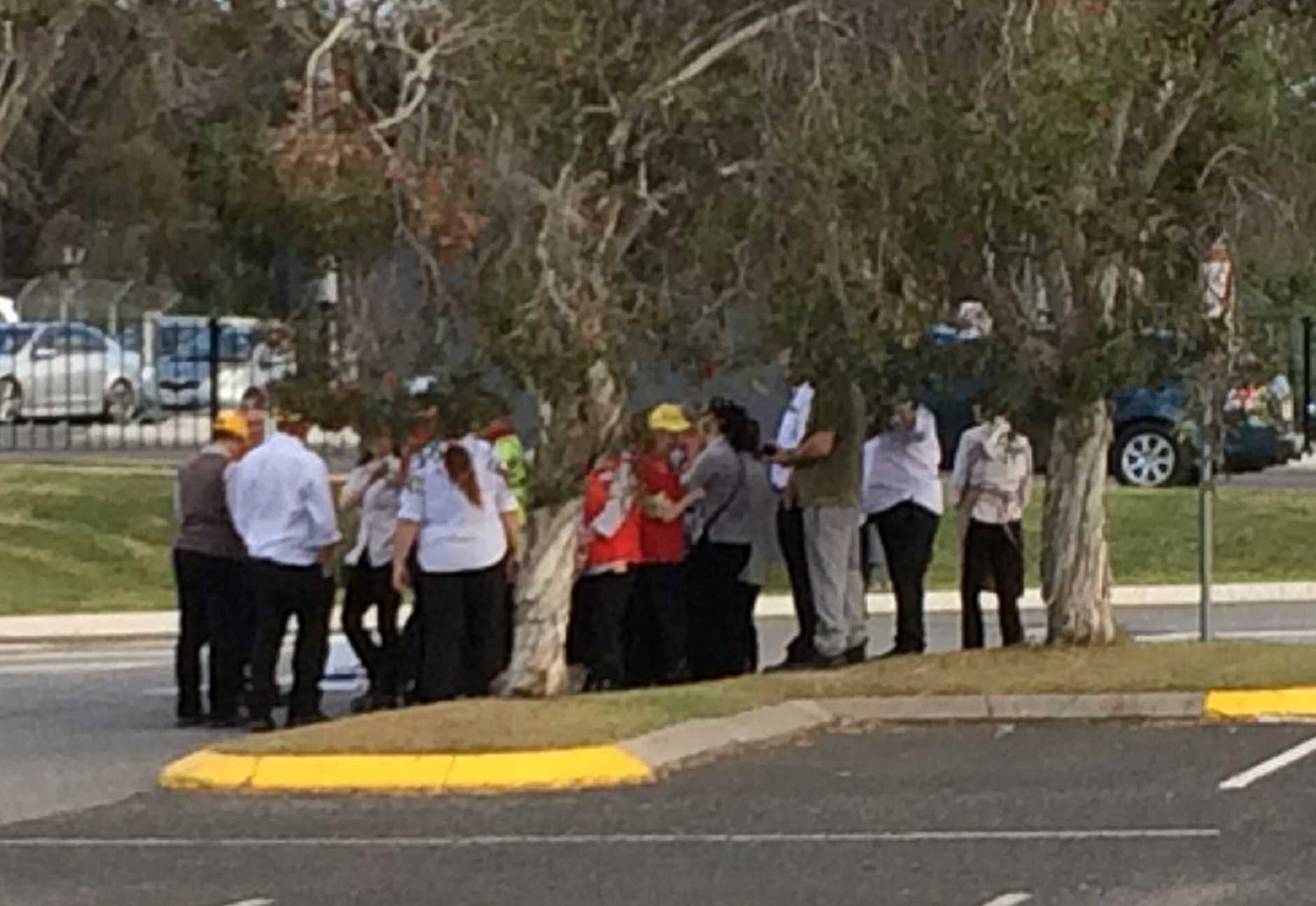 EVACUATED:Employees wait outside the stores while firefighters work to locate the source of a strong smell of smoke.