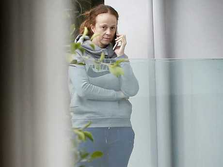 George Calombaris' wife Natalie on the phone. Picture: David Caird