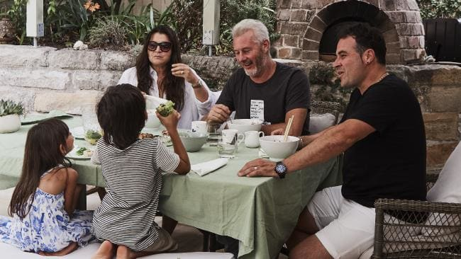 Barry Du Bois and his colleague Miguel Maestre (pictured here with Barry's family) have written a book about friendship and Barry's health battles.