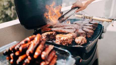 A discussion about buying real estate is as much a part of a family barbecue as a pile of freshly cooked snags. (Pic: iStock)
