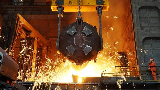 A worker works at a furnace at a steel plant in Dalian, China, earlier this month. PHOTO: REUTERS. Turnbull plays down threat of US-China trade war