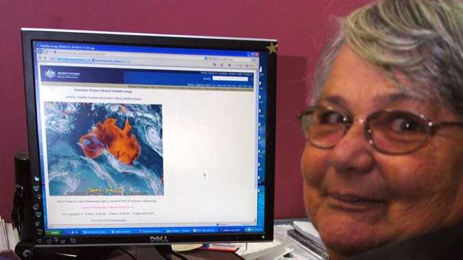 SES volunteer Helen Scott tracks the latest cyclone as it nears the Queensland coast. 10m227