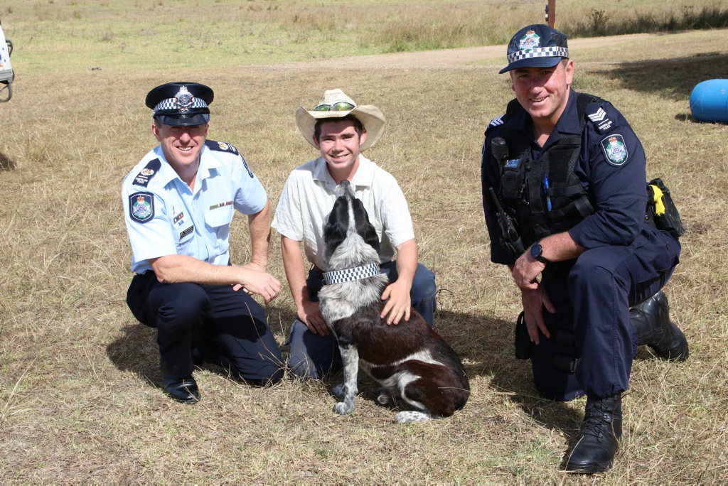 Max with Warwick OIC James Deacon (light blue uniform), Dog Squad Darling Downs OIC Sergeant Trevour O'Neil (navy uniform), one of Max's humans Jake Miller.
