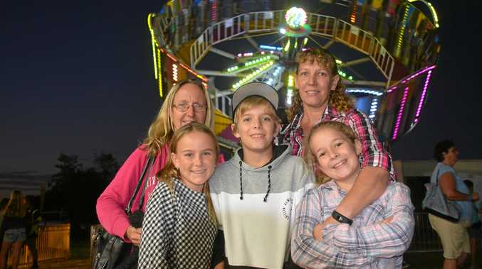 Rhiannon Snow, Sam Snow, Mitchell Schick, Molly Schick and Kathy Schick checking out the Nanango show rides on April 28, 2018.