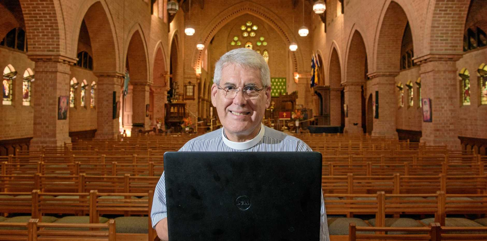 Rev Canon Greg Jenks logs onto the wireless in the Christchurch Cathedral.