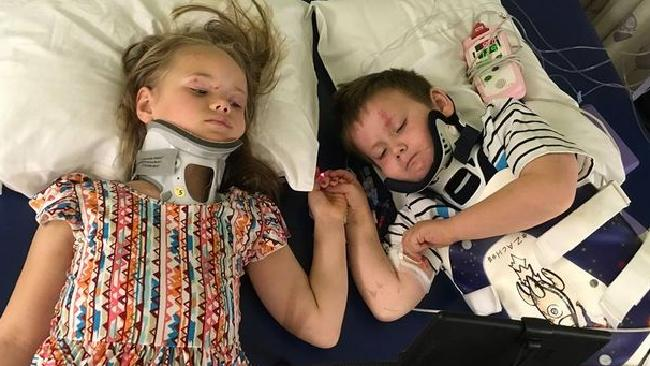Angie and Zachary Clemens clutch hands as they see each other for the first time since they were orphaned in a horror car crash. Picture: Teresa Burrell