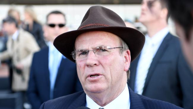 Trainer Robert Smerdon chats with media.