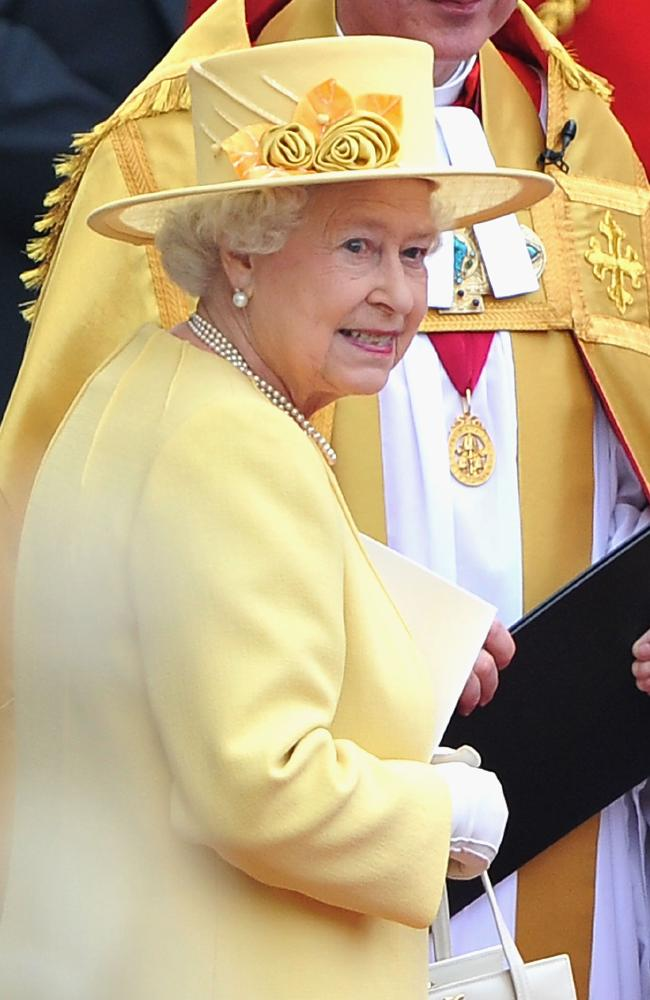 Hats are a must - just follow Queen Elizabeth II's example. (Photo by Pascal Le Segretain/Getty Images)