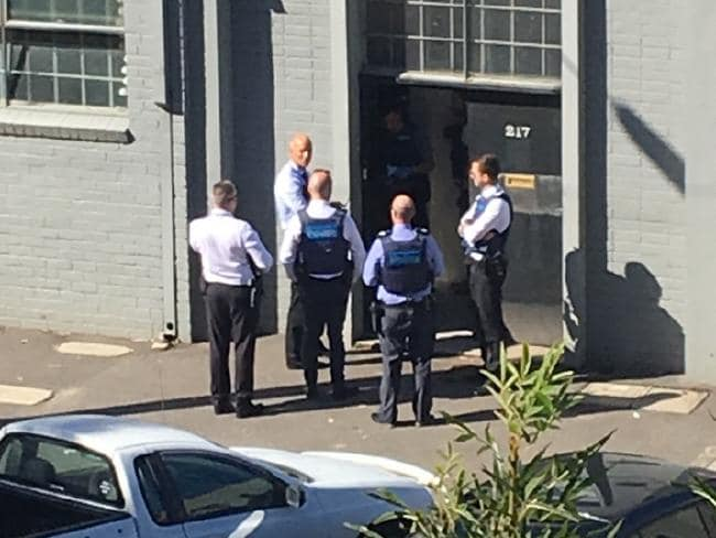 Pictures of Police raiding Mark Thompson's Port Melbourne property.