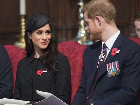 Prince Harry and Meghan Markle share a smile at an Anzac Day Service in London. Picture: MEGA