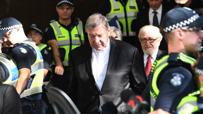 Cardinal George Pell departs the Melbourne Magistrates Court. AAP Image/Joe Castro