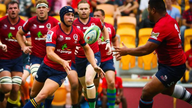Reds five-eighth Hamish Stewart makes a pass against the Lions at Suncorp Stadium.
