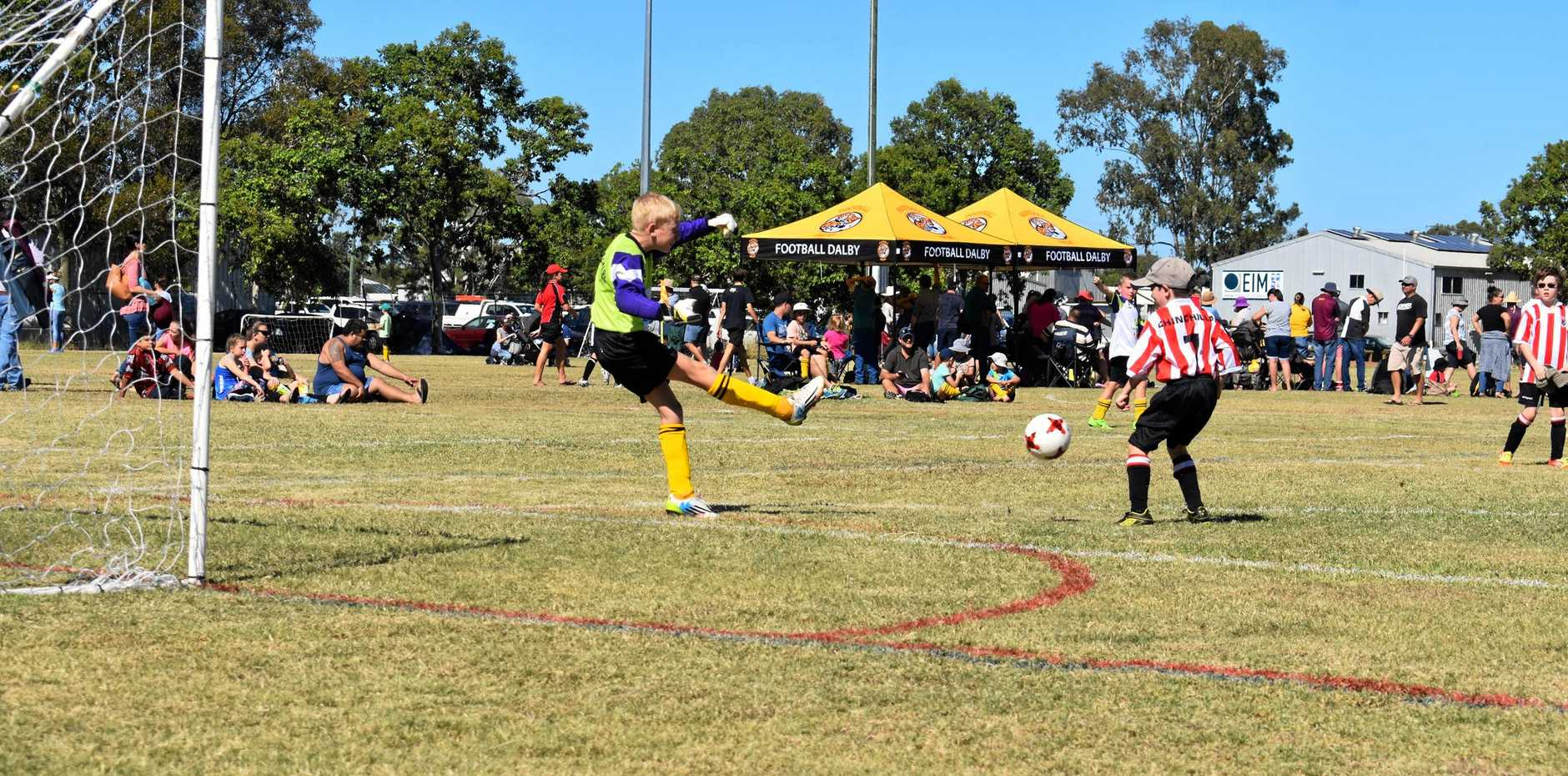 HAVING A BLAST: The Dalby Tigers goalkeeper kicks the ball on the weekend.