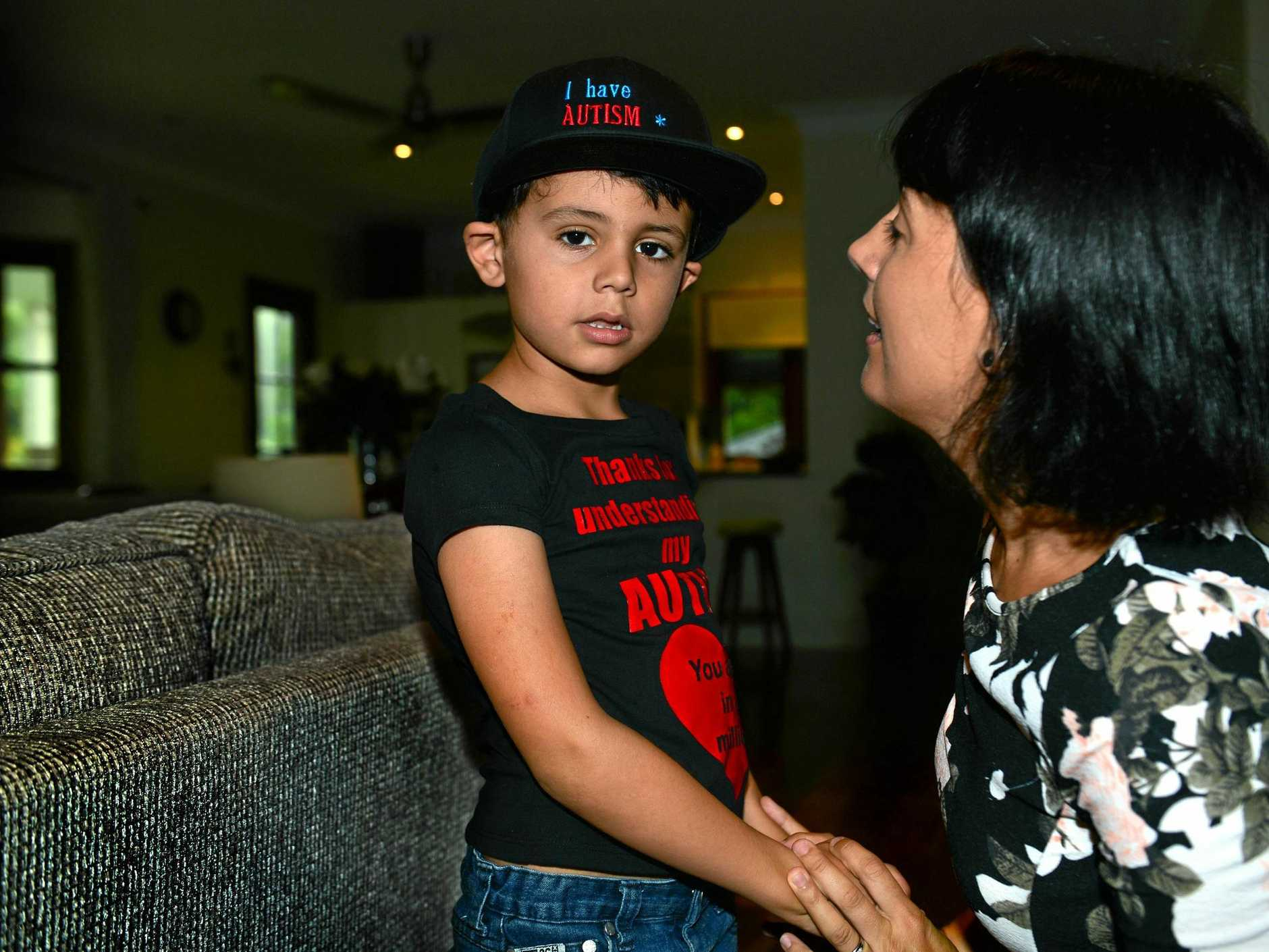 Ollie Sklenars and his mum Durrelle who designs t-shirts and other wear to increase awareness of autism.