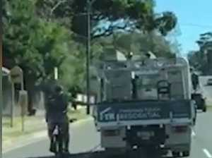 'TWO CLOWNS': Unbelievable footage of cyclist holding truck