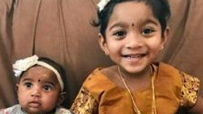 DAY IN COURT: Nades holds Dharuniga, 9 months and Priya with Kopiga, 2.