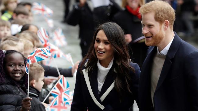 The couple greeting crowds in Birmingham. (AP Photo/Matt Dunham, File)