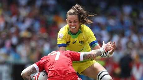 Australia's Chloe Dalton tackles Canada's Jennifer Kish during the HSBC World Rugby Women's Sevens Series semi-final at Allianz Stadium, Sydney. Picture: Brett Costello