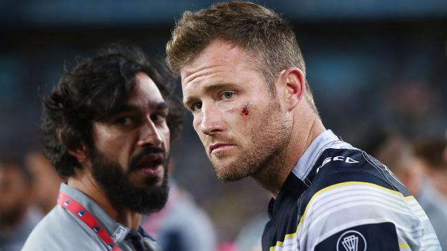 Gavin Cooper and Jonathan Thurston. Photo: Getty Images