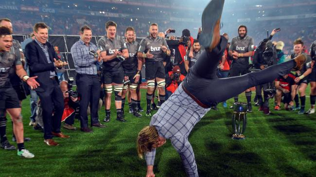 Crusaders coach Scott Robertson breakdances after winning the Super Rugby final.