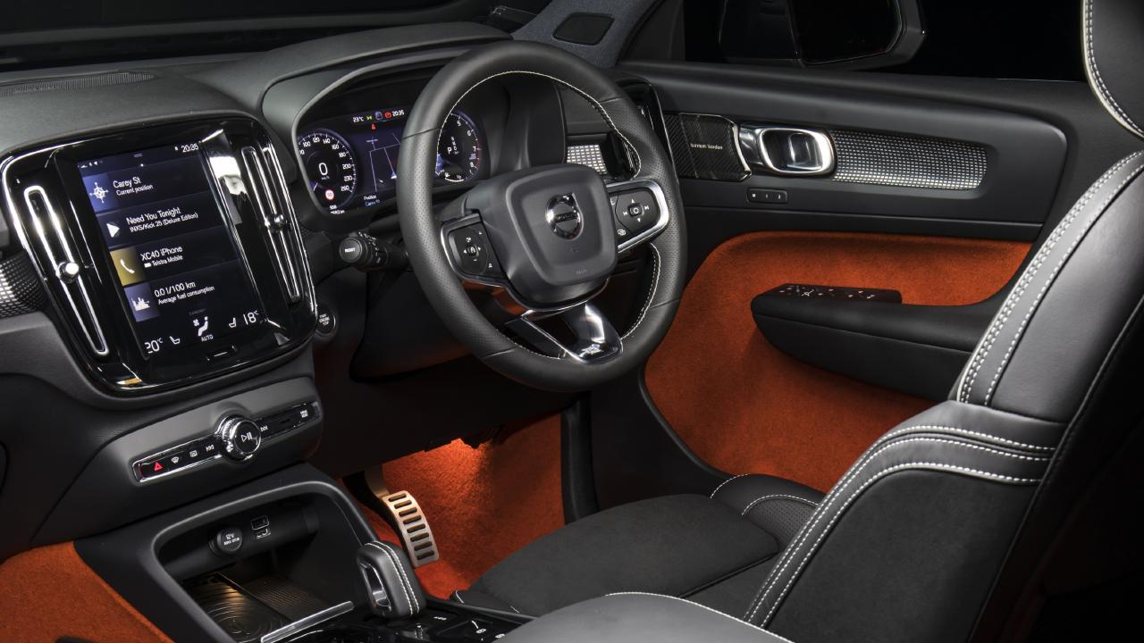 The interior of the Volvo XC40 has a tablet-sized central touchscreen and a widescreen digital instrument display. The carpet in the door pockets covers most of the door panel. Colours are optional. Picture: Supplied.