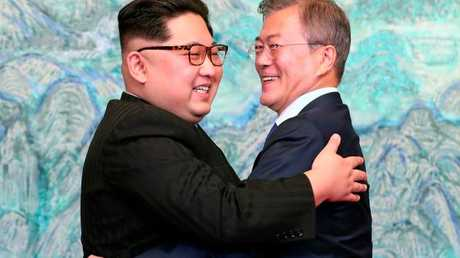 North Korean leader Kim Jong-un hugs South Korean President Moon Jae-in after signing on a joint statement at the border village of Panmunjom. Picture: Korea Summit Press Pool/AP Trump likes DMZ for Kim summit venue