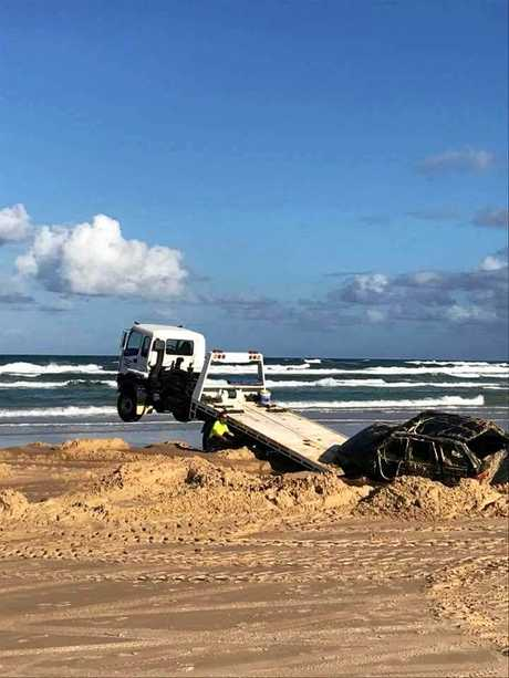 The high tide claimed a Range Rover on Fraser Island. These photos were posted to the I Got Bogged at Inskip Point Facebook page.