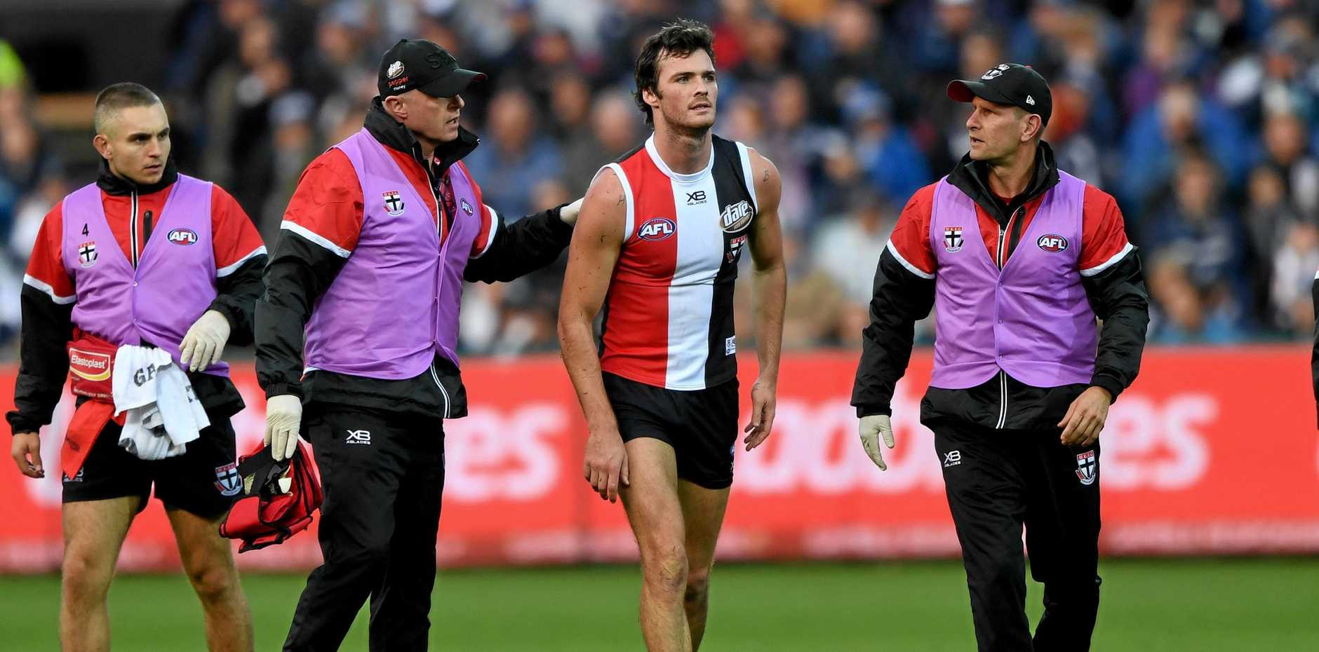 Dylan Roberton is taken off the ground after fainting during the round four match between Geelong and St Kilda Saints. Picture: Joe Castro/AAP