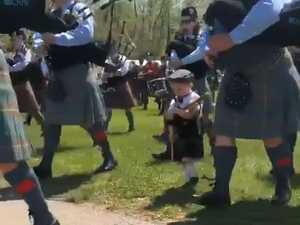Young bagpiper joins parade in US