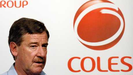 In 2006, Coles' then-CEO John Fletcher unveiled a new logo, behind him, and a plan to convert Kmart stores to 'Coles Supercentres'.