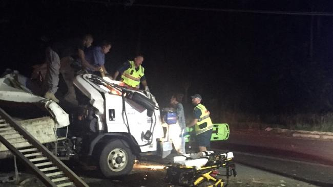 Emergency services work to free the man trapped in the cabin of the truck following a serious crash.