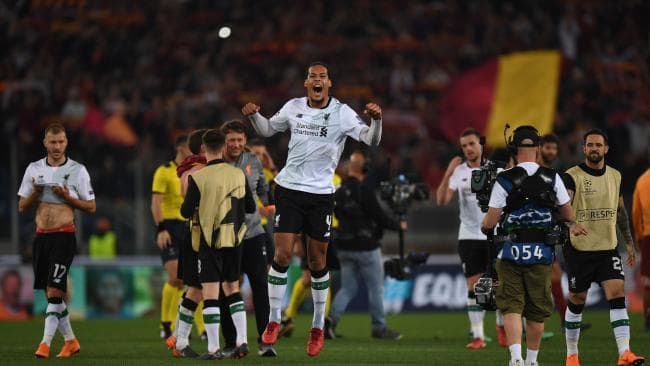Liverpool's Dutch defender Virgil van Dijk (C) celebrates