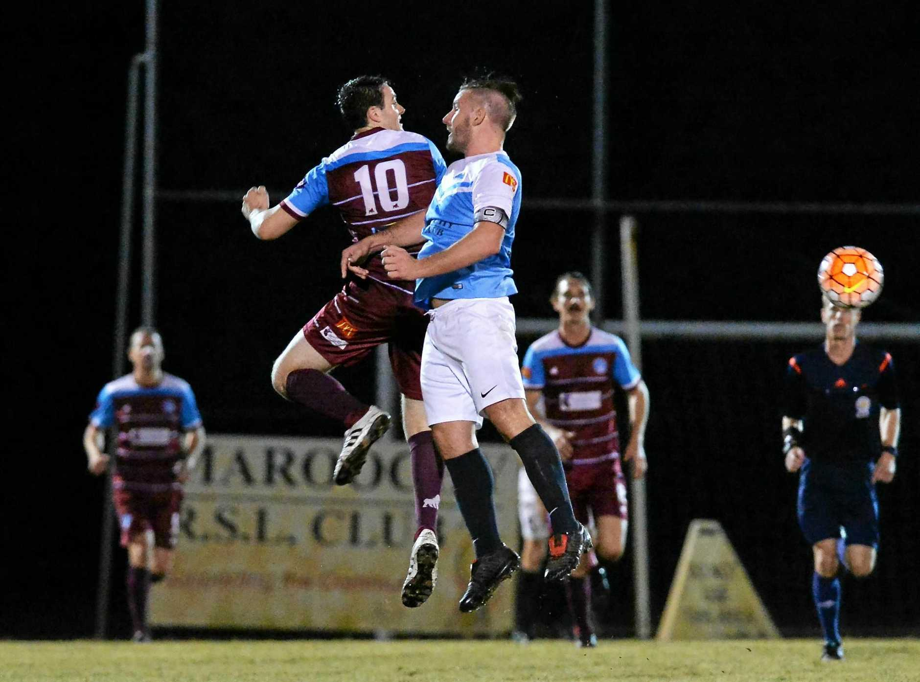 Jayden Davey goes high for the ball while playing for the Gympie Diggers.