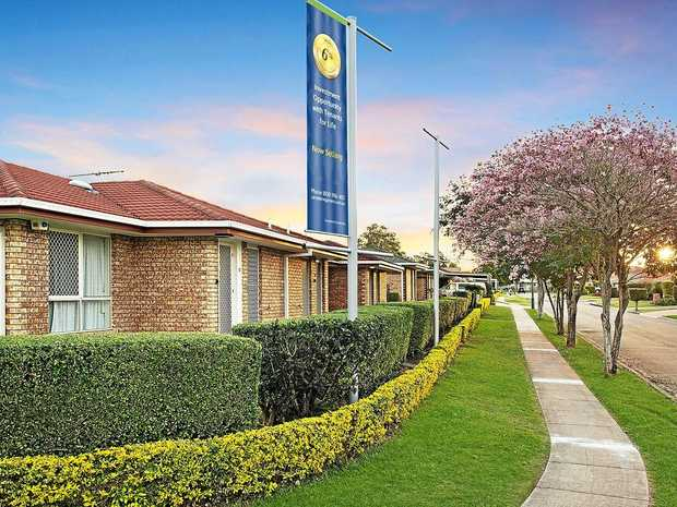 COMMUNITY LIFESTYLE: The delightful gardens and level walkway at Brisbane's Carseldine Gardens.