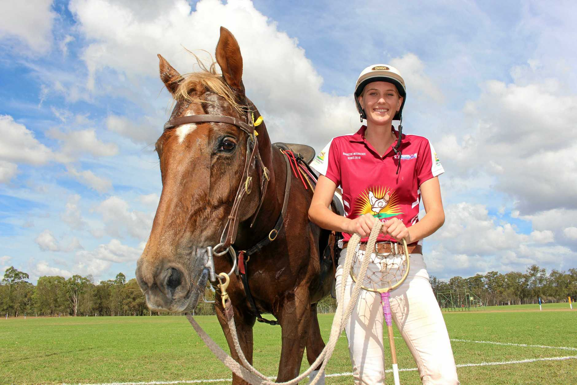 INTO THE ACTION: Polocrosse champion Ryle Waugh is off to a galloping start and has already taken out player of the match in her first game in the Barastoc Interstate Series. Pictured with her brother's horse Woody.