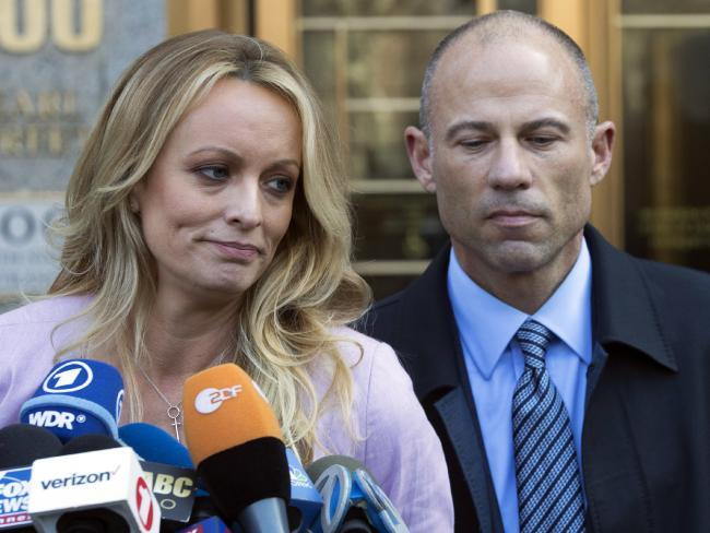 Stormy Daniels, with lawyer Michael Avenatti, claims she had a sexual tryst with Mr Trump more than a decade ago. Picture: Mary Altaffer/AP