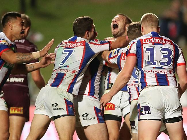 The Knights celebrate their matchwinner — set up by Ponga. Picture: Getty Images